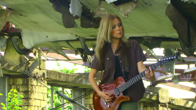 Young Woman Playing Rock