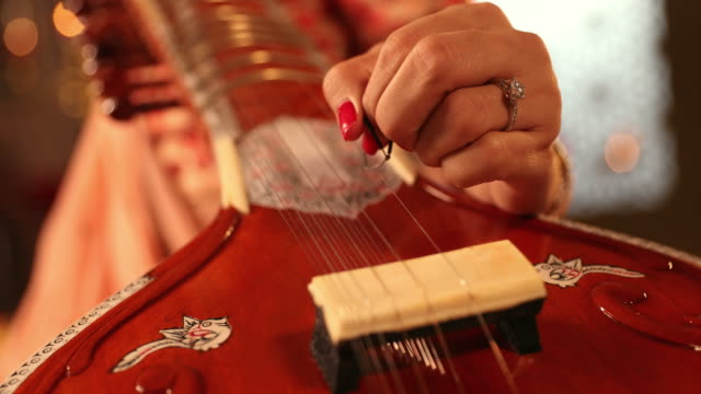cu young woman playing sitar during diwali festival / new delhi, delhi, india - musical instrument stock videos & royalty-free footage