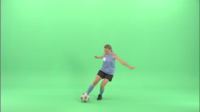 ws, young woman playing soccer in studio - neenah stock videos & royalty-free footage