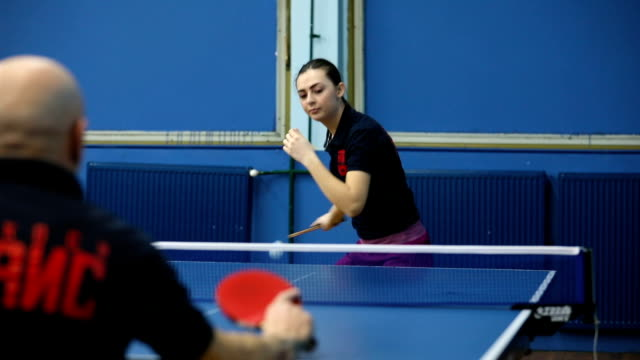 young woman playing table tennis against mature man - table tennis stock videos & royalty-free footage