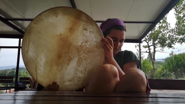 young woman playing traditional precussion instrument - drum percussion instrument stock videos & royalty-free footage