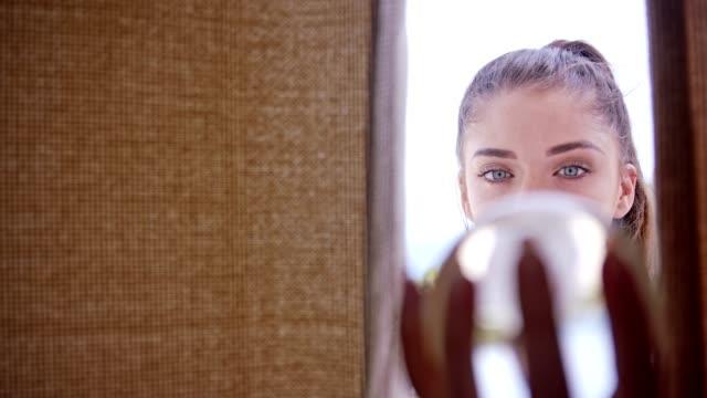 vídeos de stock e filmes b-roll de young woman playing with glass ball - model