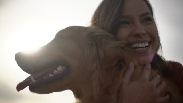 vidéos et rushes de cu young woman playing with her dog outdoors. - only women