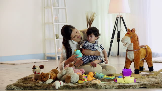 young woman playing with her son in the home - indian mom stock videos & royalty-free footage