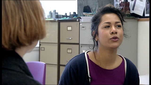 young woman pleads to keep benefits for under25s int poppy seen through classroom talking to her old school teacher poppy in conversation with her... - 女性教師点の映像素材/bロール