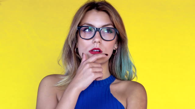 young woman posing in a thougtful way. facial expressions - frowning stock videos & royalty-free footage