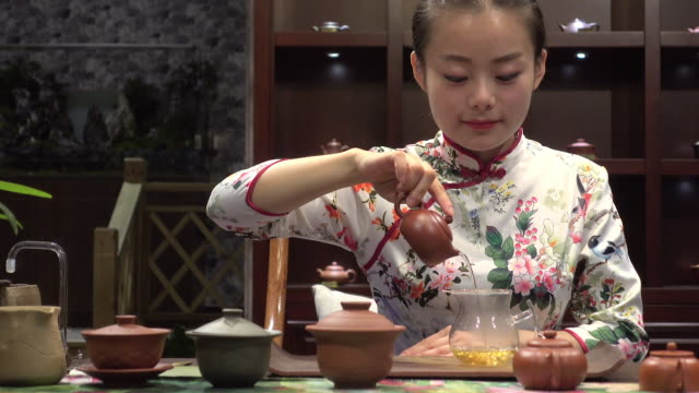 young woman pouring tea - floral pattern stock videos and b-roll footage