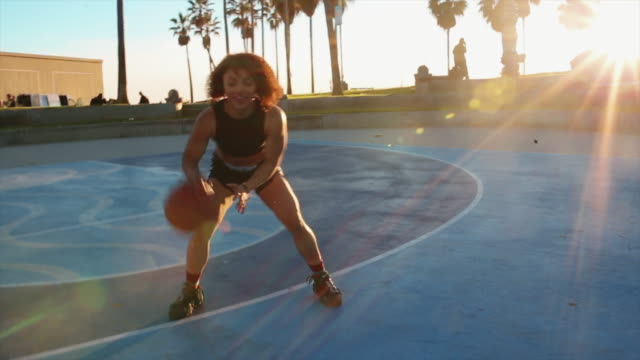 young woman practice basketball on the venice beach courts - bouncing stock videos & royalty-free footage