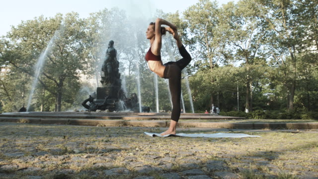 A young woman practices Yoga, alone in Brooklyn, NYC - 4k - slow motion