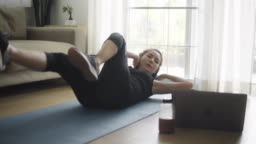 Young woman practicing exercise at home