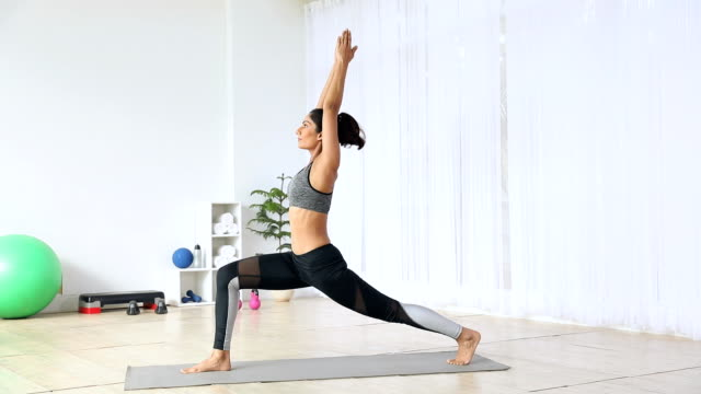 young woman practicing yoga at home, delhi, india - sun salutation stock videos and b-roll footage