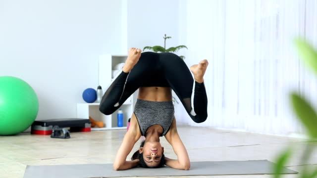Young woman practicing yoga at home, Delhi, India