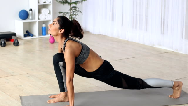 young woman practicing yoga at home, delhi, india - sun salutation stock videos & royalty-free footage