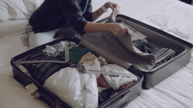 young woman preparing bag for travel at home. - suitcase stock videos & royalty-free footage