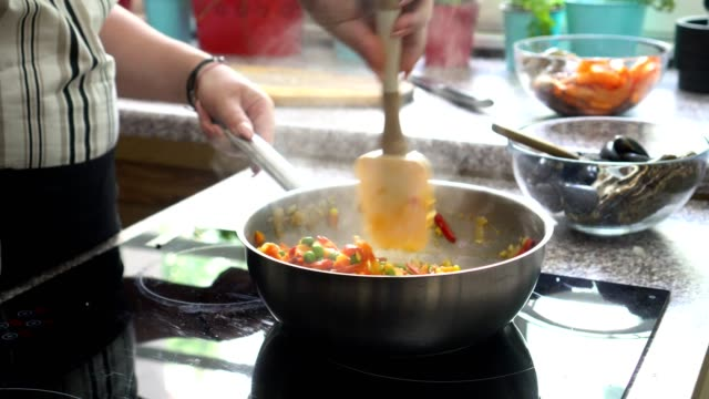 young woman preparing paella - one mid adult woman only stock videos & royalty-free footage