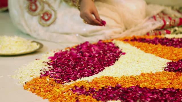 Young woman preparing rangoli in diwali festival