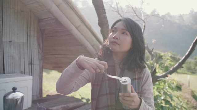 young woman preparing to make coffee at camping table in front of home in the forest. - kitchenware department stock videos and b-roll footage
