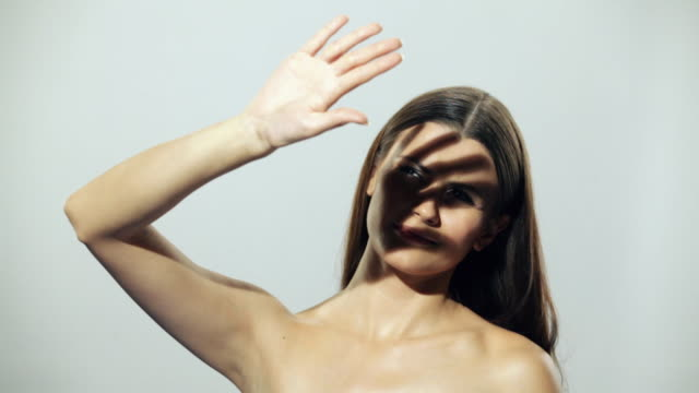 young woman protecting face from sunlight  - schutz stock-videos und b-roll-filmmaterial