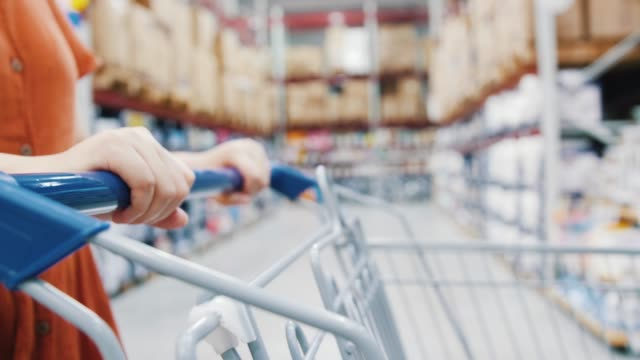 young woman pulling a shopping cart - handle stock videos & royalty-free footage