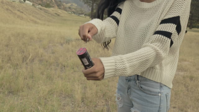 young woman pulls smoke grenade - sleeve stock videos and b-roll footage