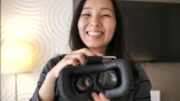 Young woman put on VR Glasses