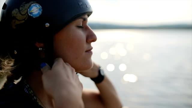 young woman puts protective sport helmet for kayak training - using a paddle stock videos & royalty-free footage