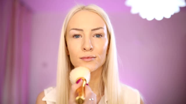 young woman putting make up - side hustle stock videos & royalty-free footage