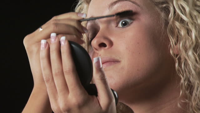 young woman putting on mascara - see other clips from this shoot 1163 stock videos & royalty-free footage