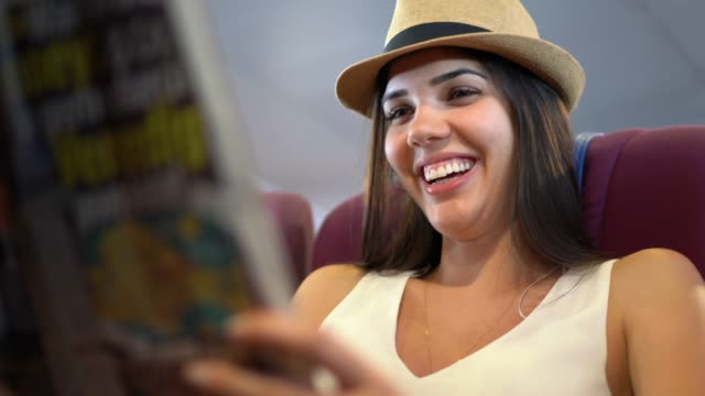 young woman reading a newspaper in a ferry - ferry stock videos & royalty-free footage