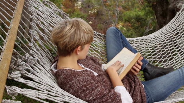 ms young woman reading book in hammock / big sur, california, usa - reading stock videos & royalty-free footage