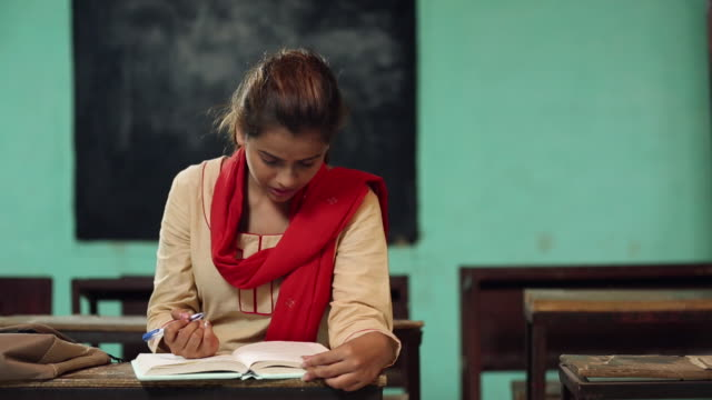 young woman reading book in the classroom, haryana, india - dedication stock videos and b-roll footage