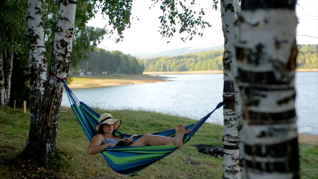 young woman reading book in the nature - reclining stock videos & royalty-free footage