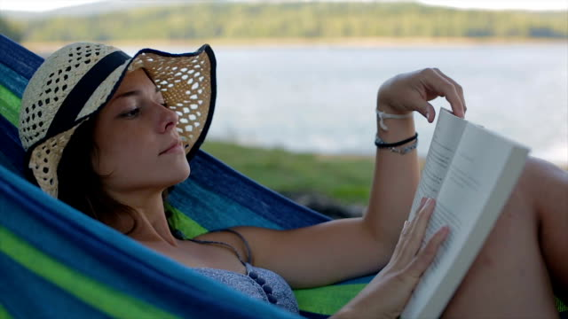 young woman reading book in the nature.close up - hammock stock videos and b-roll footage