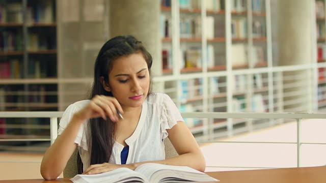 Young woman reading books, Noida, Uttar Pradesh, India