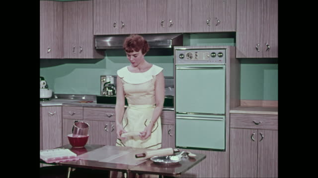 ms pan young woman reading recipe book and preparing food in domestic kitchen / united states - refrigerator stock videos and b-roll footage