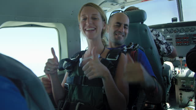 young woman ready to tandem jump - caucasian appearance stock videos & royalty-free footage