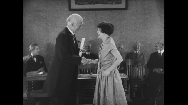 1927 a young woman (anne cornwall) receives her diploma - diploma stock videos and b-roll footage