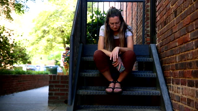 young woman receives sad text - furious stock videos & royalty-free footage