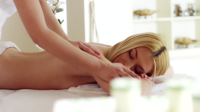 Young woman receiving back massage