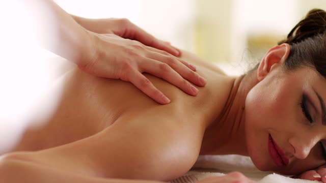 young woman receiving back massage - spa treatment stock videos & royalty-free footage
