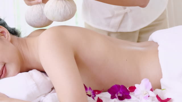 Young woman receiving back spa massage for relax.