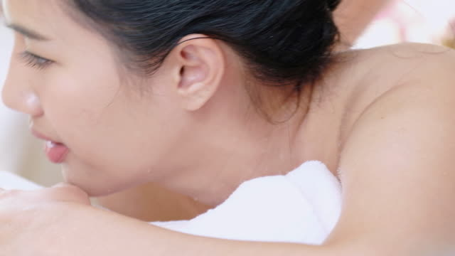 young woman receiving back spa massage for relax. - beautification stock videos and b-roll footage