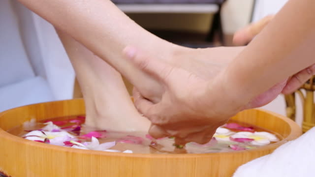 Young woman receiving foot spa massage for relax.