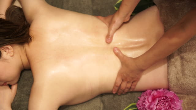 young woman receiving oil massage - massage stock videos & royalty-free footage