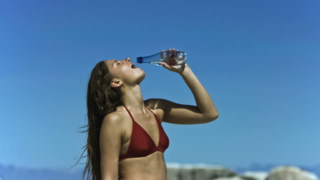 young woman refreshing in slow motion - one young woman only stock videos & royalty-free footage