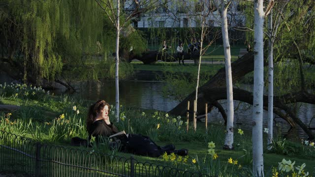young woman relaxes and reads a book by the lake in regents park on march 29, 2021 in london, united kingdom. today the government eased its rules... - content stock videos & royalty-free footage