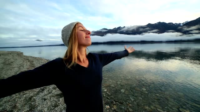 young woman relaxes by the lake in autumn - queenstown stock videos & royalty-free footage