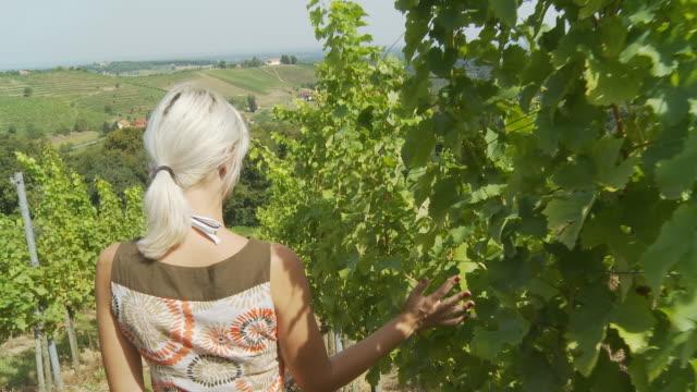 HD: Young Woman Relaxing In A Vineyard