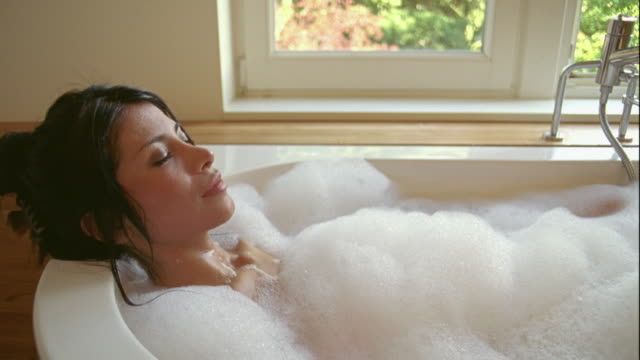 cu, young woman relaxing in bubble bath, brussels, belgium - bubble bath stock videos and b-roll footage