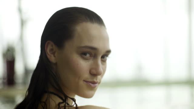 stockvideo's en b-roll-footage met young woman relaxing in pool - binnenbad